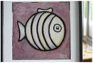 White fish painting with stripes